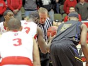 Referee prepares for tip-off